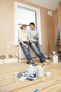 18792587-couple-holding-coffee-mugs-while-looking-at-each-other-in-unrenovated-house